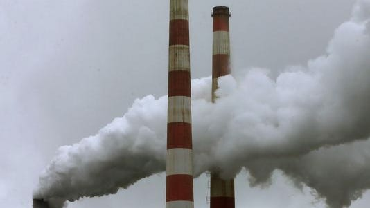 Emissions spew out of a large stack at the coal-fired Morgantown Generating Station on May 29 in Newburg, Md.