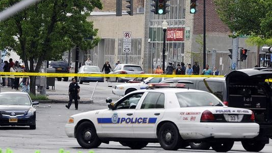 City of Poughkeepsie police investigate the scene on Main Street that left one man dead and an officer injured after an incident early this morning in the City of Poughkeepsie, authorities said.