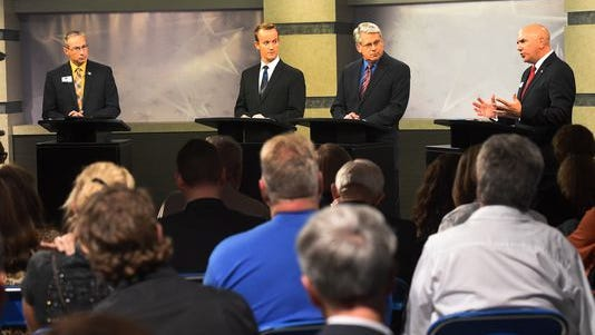 Washoe County Sheriff candidates Chuck Allen, far left, and Tim Kuzenek, far right, during Thursday evening's debate.