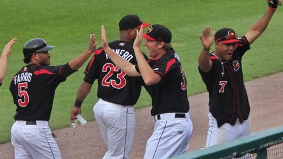 Eric Farris, Deibinson Romero and the rest of the Red Wings celebrate Monday's most unusual no-hitter.