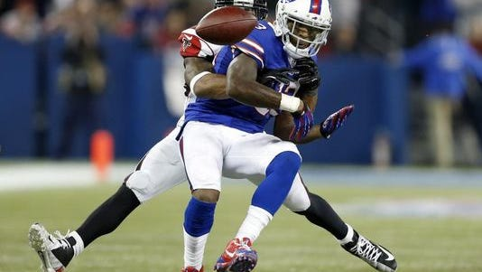 Buffalo Bills wide receiver Stevie Johnson fumbles as he is tackled by Atlanta Falcons cornerback Robert McClain during the Bills final drive in regulation.