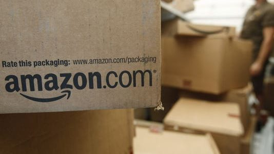 An Amazon.com package awaits delivery from UPS in Palo Alto, Calif.