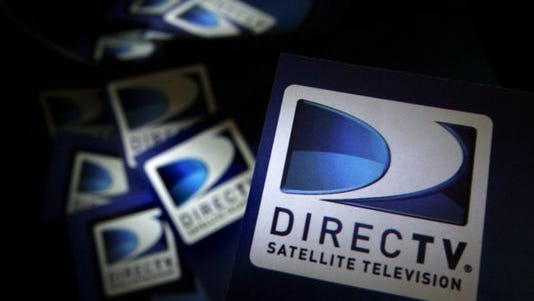 In this Thursday, Aug. 6, 2009, file photo, DirecTV logos are seen on flyers in North Andover, Mass. From 2008 to 2013, earnings per share of DirecTV nearly quadrupled, due mostly to the company cutting the number of its shares in circulation by purchasing them from investors.