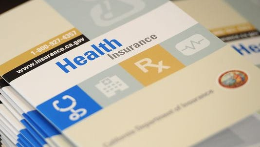 A health insurance guide at a recent event in California.