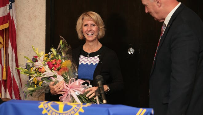 Cindy Carris is honored as the Florence Rotary Club Citizen of the Year with a bouquet of flowers. Carris, 52, of Edgewood, is the president of Mary Rose Mission, a nonprofit Catholic organization. An active community volunteer for many years, Carris was instrumental in opening the Mary Rose Mission Soup Kitchen on Main Street in Florence in 2013.