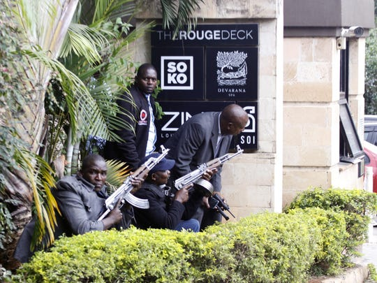 Security forces are seen at the scene of a blast in Nairobi, Tuesday, Jan. 15, 2019. Terrorists attacked an upscale hotel complex in Kenya's capital Tuesday, sending people fleeing in panic as explosions and heavy gunfire reverberated through the neighborhood. (AP Photo/Khalil Senosi)