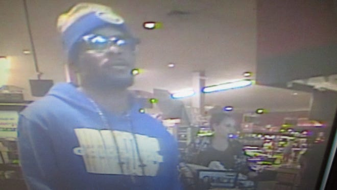 Sparks police are looking for this man, who is suspected of stealing $9,000 worth of alcohol from a Sparks grocery store.