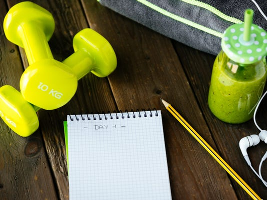 Fitness workout routine blank notebook and detox smoothie