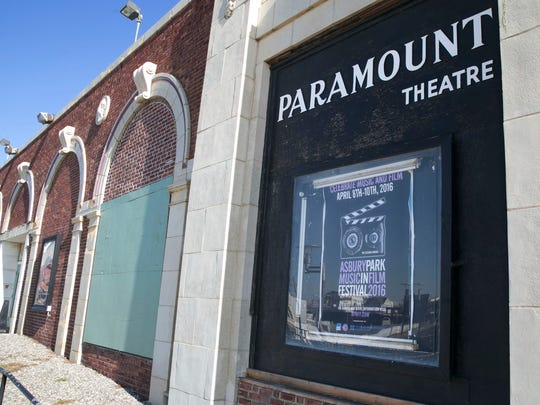 A poster on the Paramount Theater advertising the Music