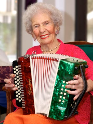 Grace Littlefield plays accordion at The Health Center of Merritt Island, where 102-year-old Littlefield is a resident.