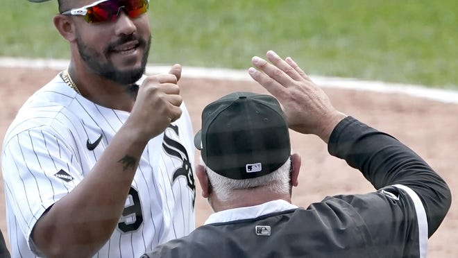 Chicago White Sox's Jose Abreu, left, and manager Rick Renteria celebrate after the White Sox clinched a playoff berth Thursday in Chicago.