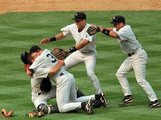 Joe Girardi and Derek Jeter were teammates for four years in the late '90s. Here, pitcher David Cone falls into the arms of Girardi, left, as Jeter, center, and Chuck Knoblauch join in the celebration after Cone threw a perfect game against the Montreal Expos during Yogi Berra Day at New York's Yankee Stadium Sunday, July 18, 1999.