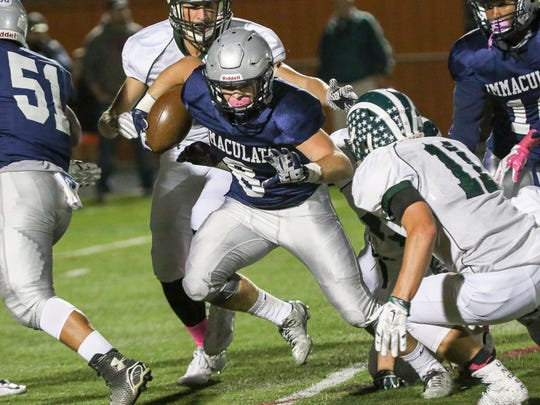 Immaculata's Colin Mullen (8) moves the ball against Ridge in Somerville on October 14, 2016.