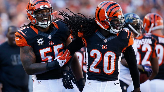 The Cincinnati Bengals free safety Reggie Nelson (20) and outside linebacker Vontaze Burfict (55) celebrate after a third quarter third down stop against the Baltimore Ravens at Paul Brown Stadium.  The Enquirer/Jeff Swinger