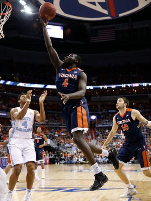 Virginia guard Marial Shayok (4) shoots against North Carolina forward Isaiah Hicks (4) during the first half of an NCAA college basketball game in the championship of the Atlantic Coast Conference tournament, Saturday, March 12, 2016, in Washington. (AP Photo/Alex Brandon)