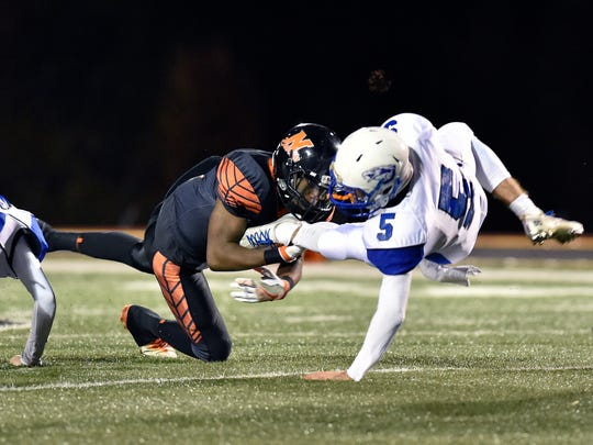 Northeastern's Coby Motley breaks up a drive by Cocalico's Colton Goodman in the second half of a PIAA District 3 Class 5A first-round football game Friday, Nov. 11, 2016, at Northeastern. Cocalico defeated Northeastern 25-24 to advance to the next round.