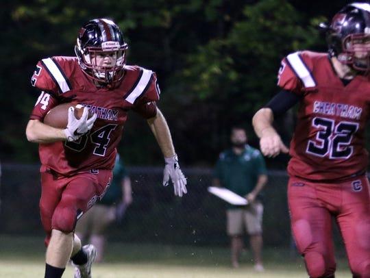 Cheatham County's Walker Bunce runs the football against