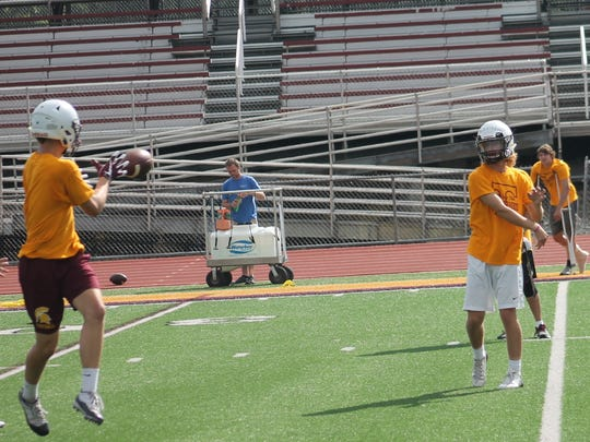 Turpin junior quarterback Justin Silverstein completes a pass during a workout.