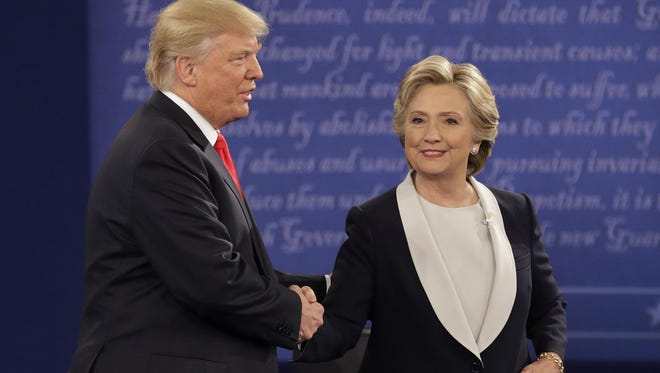 Republican presidential nominee Donald Trump shakes hands with Democratic presidential nominee Hillary Clinton after the second presidential debate at Washington University in St. Louis.