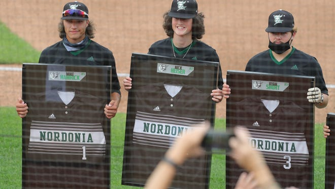 From left, Nordonia seniors Mike Hamrick, Nick Heiser and Ryan Short pose for a photo before a game against Wadsworth Thursday at Canal Park in Akron.