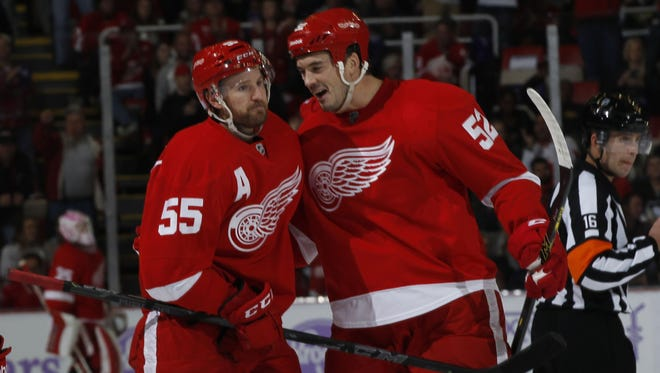 The Detroit Red Wings' Niklas Kronwall (55) is congratulated by Jonathan Ericsson on Oct. 23, 2014.