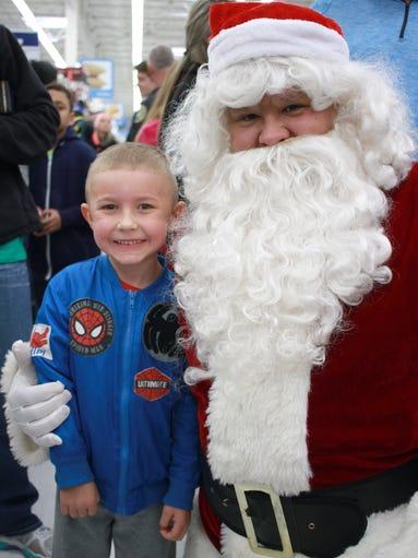 Crimson Inman (5) poses with Santa at Walmart for Shop