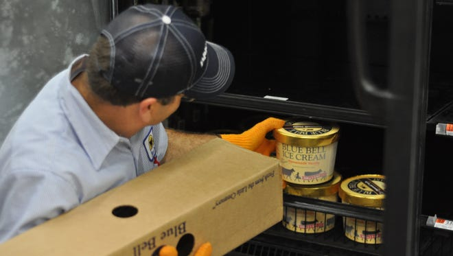 Dean Carpenter, the route salesman for Blue Bell in Alexandria, restocks shelves with ice cream early Monday morning at the Wal-Mart Neighborhood Market on Belleau Wood Boulevard off Jackson Street Extension in Alexandria.