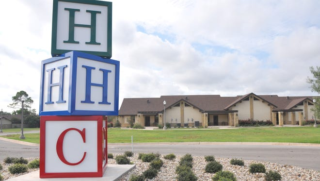 "The maintenance staff at Hendrick Home for Children constructed the giant block statue on the new street built on the west side of the campus when the A.L. ""Dusty"" and Nancy Rhodes Family Care Complex opened in 2016."
