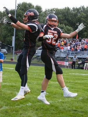 Dell Rapids Tate Kolbeck (4) and Drew Van Regenmorter (52) greet each other before the game against Dakota Valley on Friday, Aug. 24, 2018 at Dell Rapids High School.