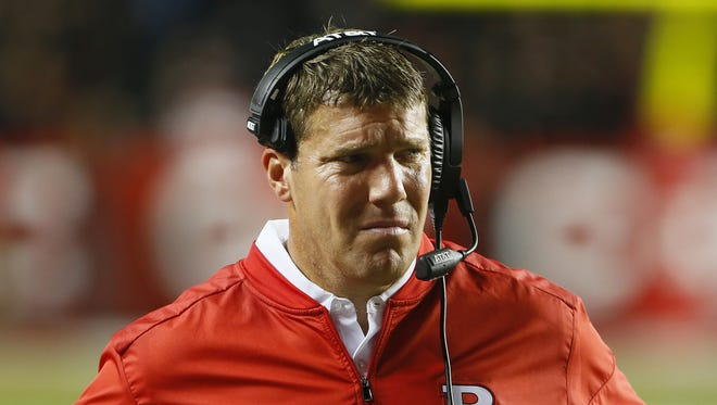 Rutgers Scarlet Knights head coach Chris Ash rects after Michigan Wolverines made a two point conversion during first half at High Point Solution Stadium.
