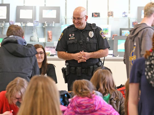 Ontario school resource officer Adam Gongwer enjoys interacting with students and staff early Thursday morning.