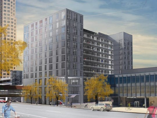 Des Moines-based Nelson Construction & Development plans to build this 12-story apartment and commercial building at Seventh Street and Grand Avenue.