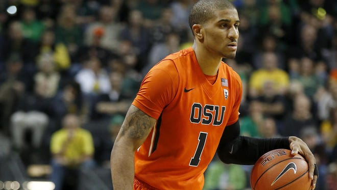 Oregon State's Gary Payton II dribbles the ball during the second half of an NCAA college basketball game against Oregon Saturday, Feb. 20, 2016, in Eugene, Ore. (AP Photo/Ryan Kang)