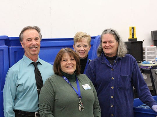 From left, front, are Sharri Moose, supervisor, Marion Goodwill; and Jane; and back; Ken Padgett, job developer, MCBDD; and Beth Whitaker, manager, Marion Goodwill
