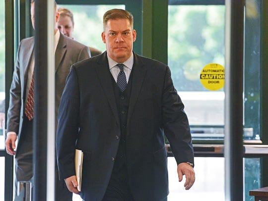 Minnehaha County State's Attorney Aaron McGowan walks