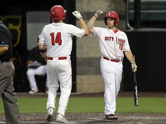 City High's Dylan Deshler (14) and Joey Schnoebelen