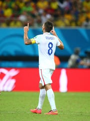 Clint Dempsey (8) celebrates after scoring a goal in