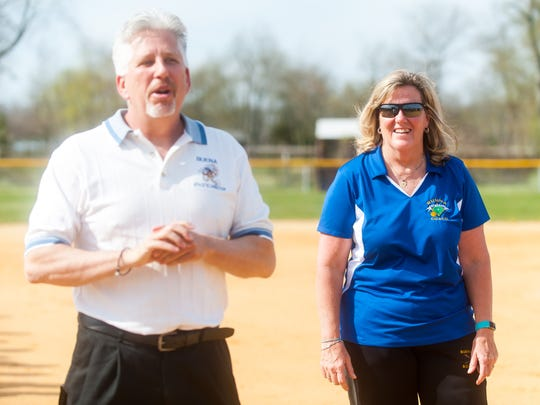 Buena softball coach Pam Pickett listens to Athletic Director Dave Albertson as she is honored for her 600th win before taking on OLMA at Buena Regional High School on Tuesday, April11.