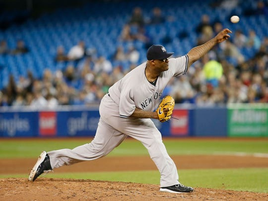 Jun 5, 2018; Toronto, Ontario, CAN; New York Yankees pitcher CC Sabathia (52) pitches to the Toronto Blue Jays in the sixth inning at Rogers Centre.