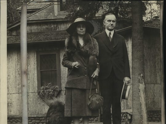 President Calvin Coolidge and his wife, Grace, arrive for their summer on the Brule in 1928.
