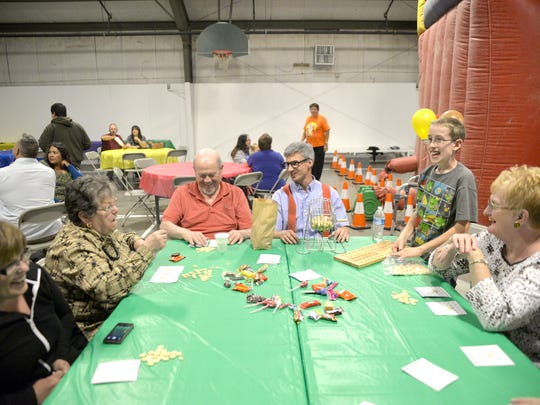 Participants play bingo on Oct. 29 during the Fall