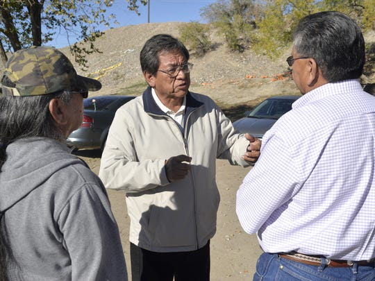 Navajo Nation presidential candidate Russell Begaye speaks with a group of peolpe outside the Shiprock Chapter house on Nov. 4, 2014, during a general election.
