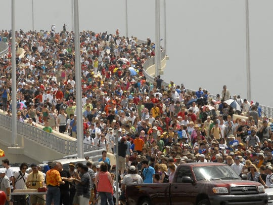 7/8/11 After the final space shuttle launch, which was Atlantis,crowds pour over the A. Max Brewer bridge in Titusville.
