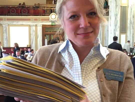 Rep Ellie Hill, D-Missoula, holds a stack of messages