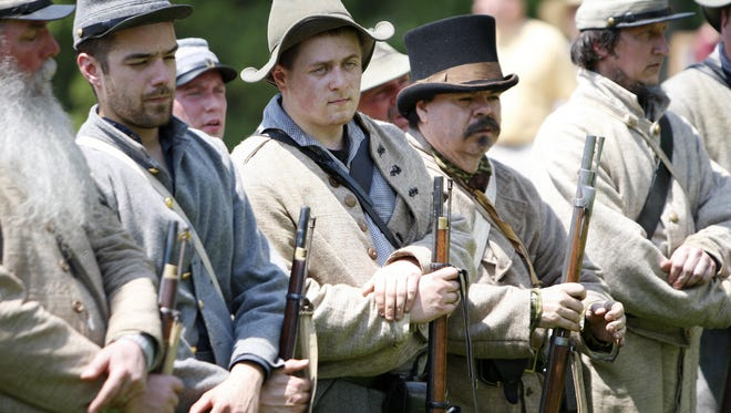 Civilian re-enactors, portraying Confederate soldiers, line up at attention after demonstrating the Civil War's Battle of Shiloh, during the Heritage Village Museum's 2012 Civil War Weekend at Sharon Woods Park. James A. Ramage Civil War Museum will host a lecture series throughout the month of June, with topics including runaway slaves, ghosts and Kentuckians.