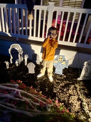 Three-year-old Julian Williams loves the Halloween decorations outside his house.