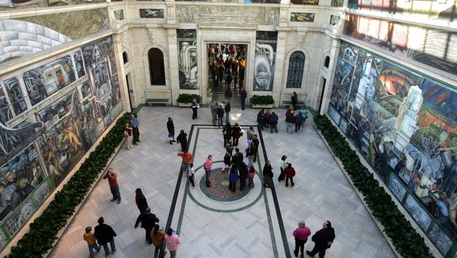 People stream through Rivera Court where the murals of Diego Rivera adorn the walls at the Detroit Institute of Arts.