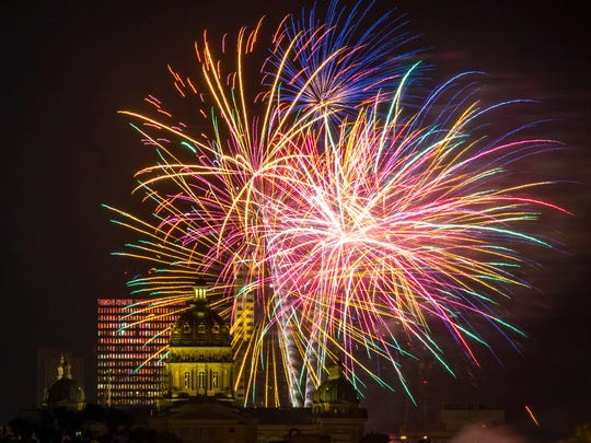 Fireworks light up the sky between the Iowa Capitol