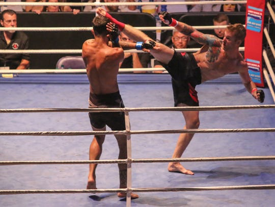 Max Mustak lands a kick during Island Fights 40  on