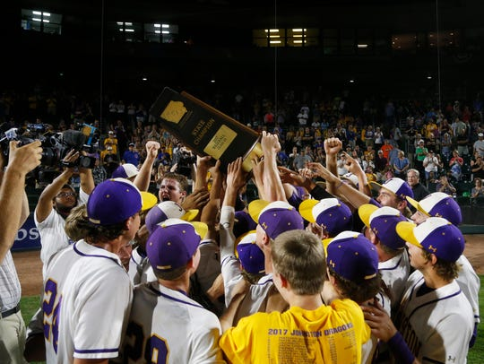 Johnston players gold up their championship trophy
